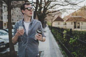 Man walking with smart phone